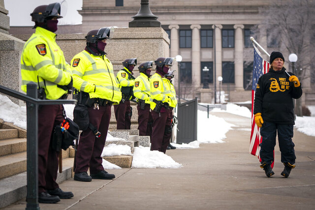 Minnesota State troopers guard the Capitol during a rally supporting President Trump at the Minnesota Capitol, Saturday, Jan. 9, 2021 in St. Paul, Minn. State Patrol officers stood in a line and guarded the steps of the Minnesota Capitol on Saturday, as roughly 100 supporters of President Donald Trump gathered to protest the results of the 2020 election. (Leila Navidi/Star Tribune via AP)