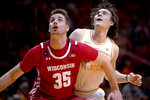 Tennessee forward John Fulkerson, right, and Wisconsin forward Nate Reuvers (35) eye the rebound during an NCAA college basketball game, Saturday, Dec. 28, 2019 in Knoxville, Tenn. on Saturday, Dec. 28, 2019. (Calvin Mattheis/Knoxville News Sentinel via AP)