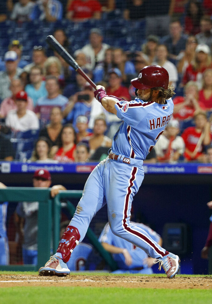 Philadelphia Phillies' Bryce Harper hits a grand slam during the ninth inning of the team's baseball game against the Chicago Cubs, Thursday, Aug. 15, 2019, in Philadelphia. Phillies won 7-5. (AP Photo/Chris Szagola)