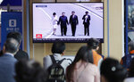 People watch a TV news program reporting about Chinese President Xi Jinping's state visit to North Korea with file footage of Xi and North Korean leader Kim Jong Un, at the Seoul Railway Station in Seoul, South Korea, Tuesday, June 18, 2019. The letters on the top read