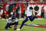 Tennessee Titans' Sam Ficken kicks a field goal against the Tampa Bay Buccaneers as punter Brett Kern (6) holds during the first half of an NFL preseason football game Saturday, Aug. 21, 2021, in Tampa, Fla. (AP Photo/Jason Behnken)