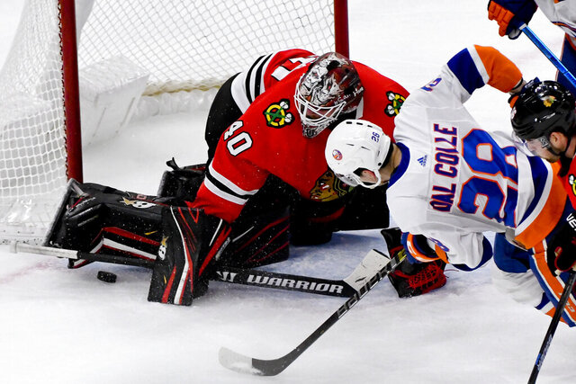Chicago Blackhawks goaltender Robin Lehner (40) defends against New York Islanders left wing Michael Dal Colle (28) during the second period of an NHL hockey game Friday, Dec. 27, 2019, in Chicago. (AP Photo/Matt Marton)