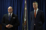 John F. Bennett, Special Agent in Charge, Federal Bureau of Investigation, left, and David L. Anderson, U.S. Attorney for the Northern District of California take questions during a media conference Tuesday, Jan. 28, 2020, in San Francisco. A top San Francisco official tasked with keeping the streets clean has been charged with public corruption in schemes that include offering a bribe for space at San Francisco International Airport, providing inside information to a friend seeking permits to build homeless shelters and accepting lavish gifts from a billionaire Chinese developer. San Francisco Public Works Director Mohammed Nuru made an initial appearance in court Tuesday along with Nick Bovis, the owner of Lefty O' Doul's, a popular sports bar in Fisherman's Wharf and other city businesses. Each was ordered held on $2 million bail. (AP Photo/Ben Margot)