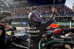 Mercedes driver Lewis Hamilton of Britain celebrates after setting the second fastest time in the qualifying session for Sunday's Formula One Dutch Grand Prix at the Zandvoort racetrack, Netherlands, Saturday, Sept. 4, 2021. (AP Photo/Francisco Seco, Pool)