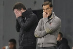 Fulham's manager Scott Parker, right, reacts during the English Premier League soccer match between Fulham and Burnley at the Craven Cottage Stadium in London, Monday, May 10, 2021. (John Walton/Pool via AP)