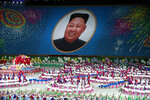 In this Wednesday, Sept. 11, 2019, file photo, performers hold up cards to form a portrait of North Korean leader Kim Jong Un during a mass games performance titled