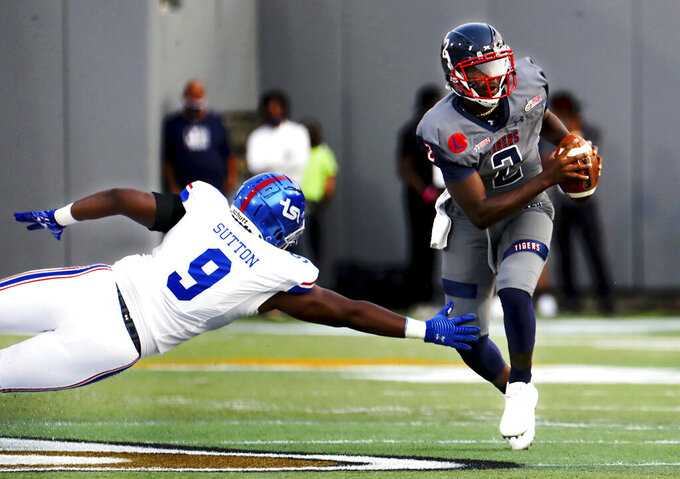 Jackson State quarterback Shedeur Sanders (2) breaks a tackle by Tennessee State defensive lineman Nate Sutton (9) during the Southern Heritage Classic NCAA college football game in Memphis, Tenn., Saturday, Sept. 11, 2021. (Patrick Lantrip/Daily Memphian via AP)