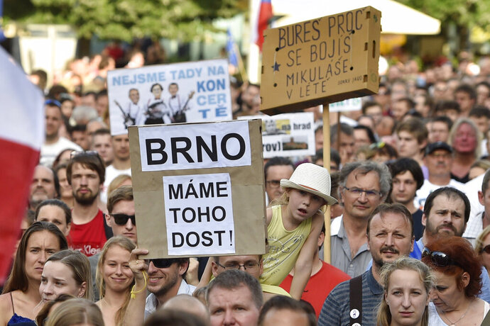 People hold a placard reading - 'Brno - We have had enough',  during a demonstration in Brno, Czech Republic, Tuesday,  June 11, 2019. Thousands of Czechs are rallying as protests demanding the resignation of Prime Minister Andrej Babis and his justice minister are intensifying across the country. The protesters gathered in hundreds places Tuesday, a week after tens of thousands rallied in Prague. A major protest is scheduled for a Prague park on June 23 if their demands aren't met. Babis repeatedly said he wouldn't resign. (Vaclav Salek/CTK via AP)