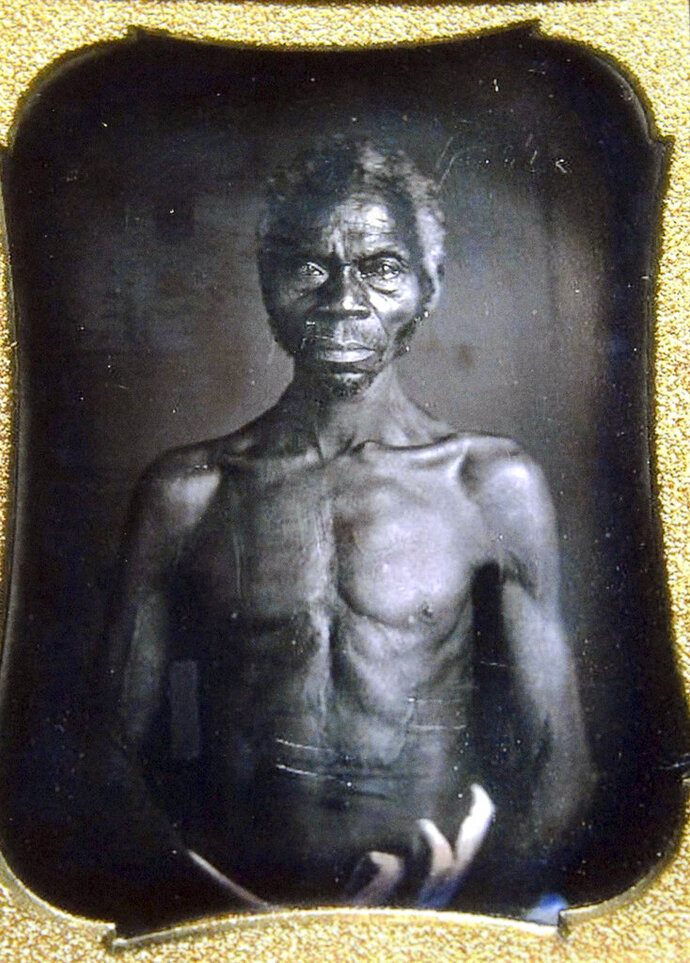 This July 17, 2018 copy photo shows a 1850 Daguerreotype of Renty, a South Carolina slave who Tamara Lanier, of Norwich, Conn., said is her family's patriarch. The portrait was commissioned by Harvard biologist Louis Agassiz, whose ideas were used to support the enslavement of Africans in the United States. Lanier filed a lawsuit on Wednesday, March 20, 2019, in Massachusetts state court, demanding that Harvard turn over the photo and pay damages. (Courtesy of Harvard University/The Norwich Bulletin via AP)