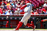 Philadelphia Phillies' Rhys Hoskins hits an RBI double off Cincinnati Reds starting pitcher Sonny Gray in the fourth inning of a baseball game, Thursday, Sept. 5, 2019, in Cincinnati. (AP Photo/John Minchillo)