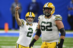 Green Bay Packers kicker Mason Crosby (2) reacts after making a 65-yard field goal during the second half of an NFL football game against the Detroit Lions, Sunday, Dec. 13, 2020, in Detroit. (AP Photo/Leon Halip)