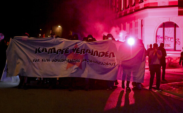 Participants of a demonstration march to support two squat dwellings through the Connewitz district of Leipzig, Germany, Saturday, Sept. 5, 2020. The demonstrators are marching under the motto