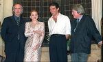 FILE - British actor Jonathan Pryce, from left, American actress-singer Madonna and Spanish actor Antonio Banderas appear at e news conference about the musical film