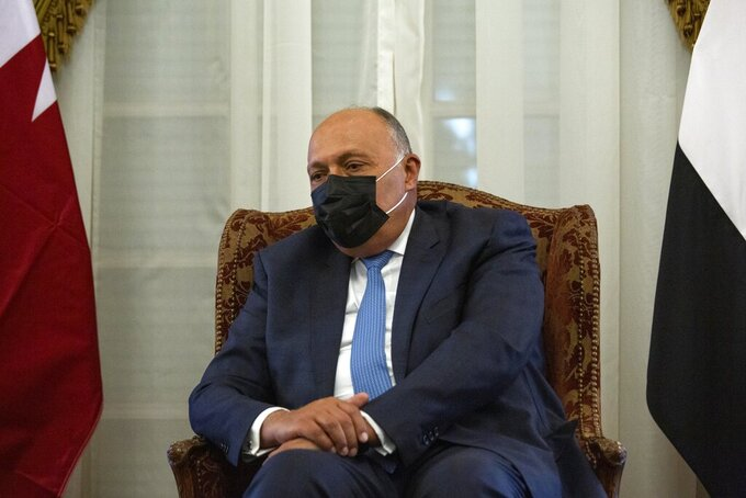 Egyptian Foreign Minister Sameh Shoukry meets with Qatar's Deputy Prime Minister and Foreign Minister Sheikh Mohammed bin Abdulrahman bin Jassim Al-Thani, at the Tahrir Palace in Cairo, Egypt, Tuesday, May 25, 2021. (AP Photo/Nariman El-Mofty)