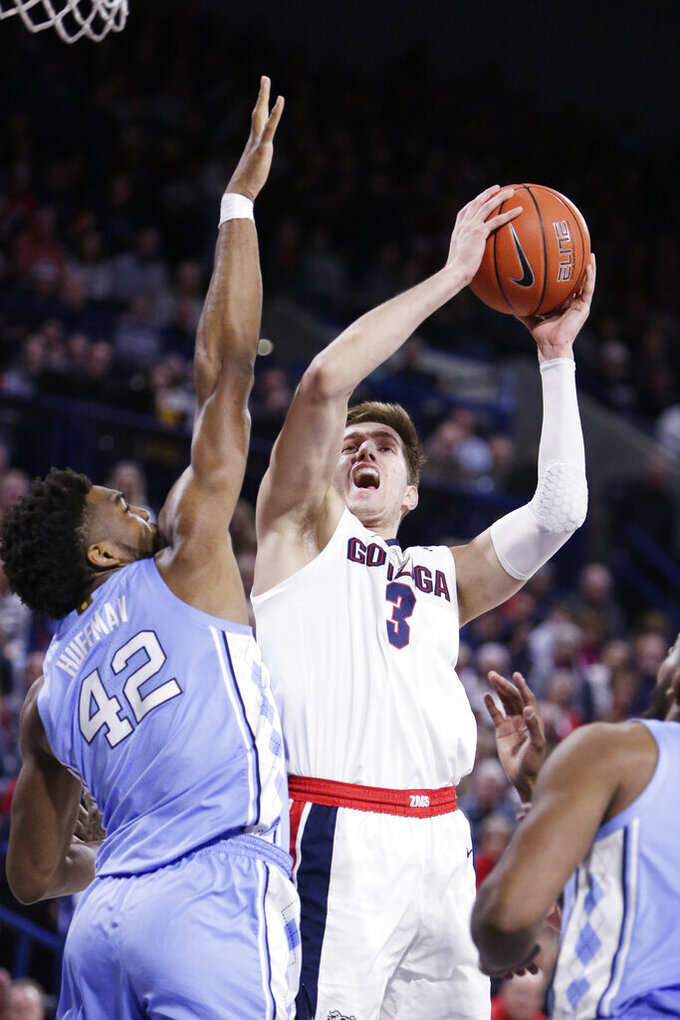 Gonzaga forward Filip Petrusev (3) shoots over North Carolina forward Brandon Huffman (42) during the second half of an NCAA college basketball game in Spokane, Wash., Wednesday, Dec. 18, 2019. Gonzaga won 94-81. (AP Photo/Young Kwak)