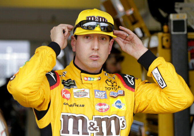 Kyle Busch adjusts his glasses during practice for the NASCAR Cup auto race at the Homestead-Miami Speedway, Friday, Nov. 16, 2018, in Homestead, Fla. (AP Photo/Terry Renna)