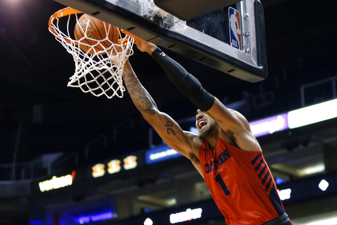 Dayton forward Obi Toppin dunks the ball against Saint Mary's during the first half of an NCAA college basketball game, Sunday, Dec. 8, 2019, in Phoenix. (AP Photo/Ralph Freso)