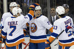 New York Islanders center Anthony Beauvillier (72) celebrates with his team mates after scoring a goal during the first period of an NHL hockey game against the New York Rangers, Saturday, Jan. 13, 2018, at Madison Square Garden in New York. (AP Photo/Mary Altaffer)