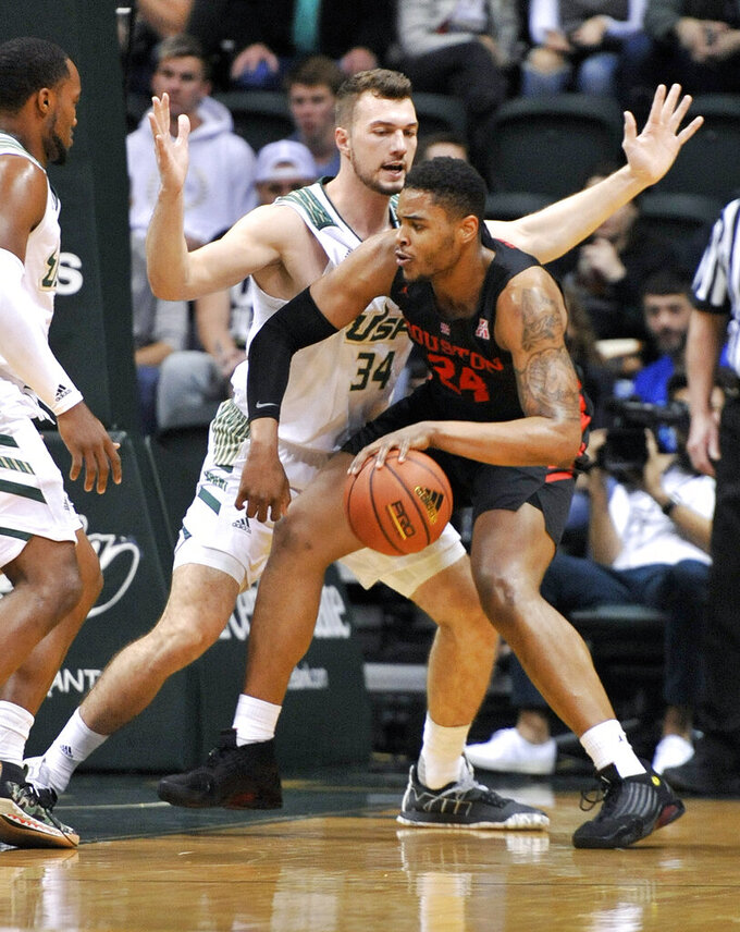 South Florida forward Antun Maricevic (34) defends against Houston forward Breaon Brady (24) during the first half of a NCAA college basketball game Saturday, Jan. 19, 2019 in Tampa, Fla. (AP Photo/Steve Nesius)