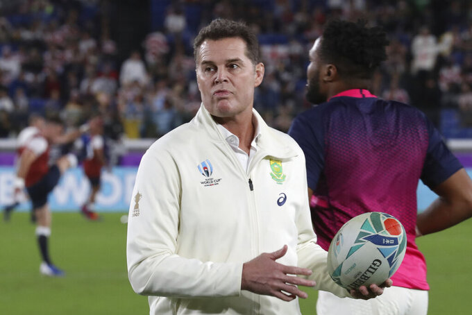 """FILE - In this Saturday, Nov. 2, 2019 file photo, Rassie Erasmus looks on ahead of South Africa's Rugby World Cup final against England at International Yokohama Stadium in Yokohama, Japan. South Africa director of rugby Rassie Erasmus says he is open to the Springboks' series against the British and Irish Lions being played in the UK and Ireland if that ensures it's not canceled. Erasmus on Monday, Jan. 18, 2021 said the Springboks """"will go to option Z"""" to make the three-test series happen amid the coronavirus pandemic. (AP Photo/Eugene Hoshiko, file)"""
