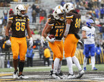 Wyoming wide receiver Raghib Ismail Jr. (17) celebrates with his teammates after scoring a touchdown against Air Force during an NCAA college football game at War Memorial Stadium Saturday, Nov. 17, 2018, in Laramie, Wyo. (Josh Galemore/The Casper Star-Tribune via AP)