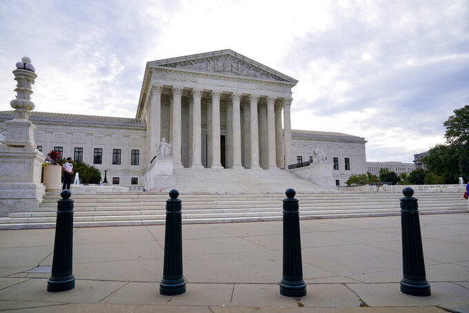 In this Oct. 4, 2021 photo, the Supreme Court is seen on the first day of the new term, in Washington.  The Supreme Court sounded ready Wednesday to reinstate the death penalty for convicted Boston Marathon bomber Dzhokhar Tsarnaev.  In more than 90 minutes of arguments, the court's six conservative justices seemed likely to embrace the Biden administration's argument that a federal appeals court mistakenly threw out Tsarnaev's death sentence for his role in the bombing that killed three people near the finish line of the marathon in 2013. (AP Photo/J. Scott Applewhite)