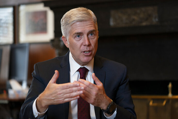 FILE - In this Sept. 4, 2019 file photo, Justice Neil Gorsuch, speaks during an interview in his chambers at the Supreme Court in Washington. Gorsuch on Friday, Sept. 20, said the conventional wisdom that the court is split along partisan lines based on the political views of the president that appointed each justice is false. Gorsuch spoke about civility at Brigham Young University refuting the notion that judges are just