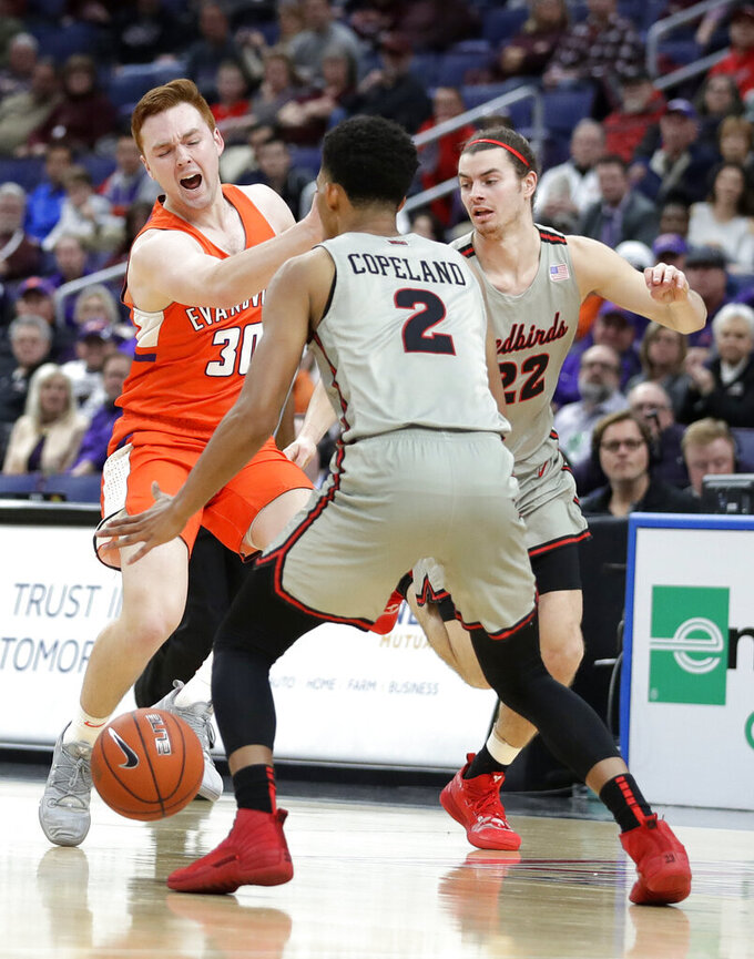 Evansville's Noah Frederking (30) tries to pass around Illinois State's Zach Copeland (2) as Illinois State's Matt Chastain (22) watches during the first half of an NCAA college basketball game in the first round of the Missouri Valley Conference men's tournament Thursday, March 7, 2019, in St. Louis. (AP Photo/Jeff Roberson)