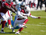 Arizona Cardinals quarterback Kyler Murray is tackled by Carolina Panthers defensive end Yetur Gross-Matos during the first half of an NFL football game Sunday, Oct. 4, 2020, in Charlotte, N.C. (AP Photo/Brian Blanco)