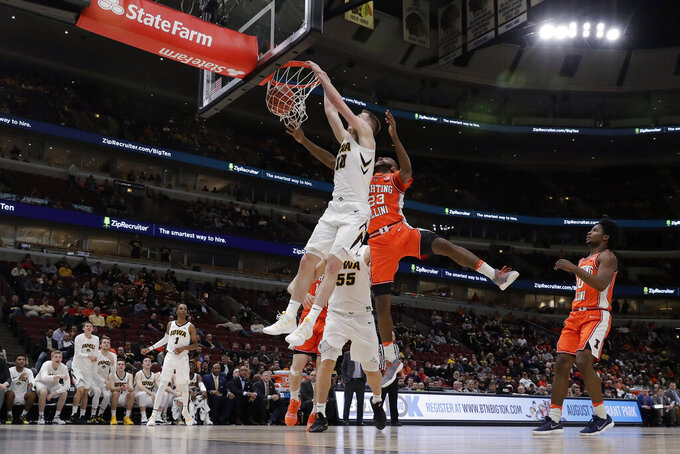Iowa's Joe Wieskamp (10) dunks against Illinois's Aaron Jordan (23) during the second half of an NCAA college basketball game in the second round of the Big Ten Conference tournament, Thursday, March 14, 2019, in Chicago. (AP Photo/Nam Y. Huh)