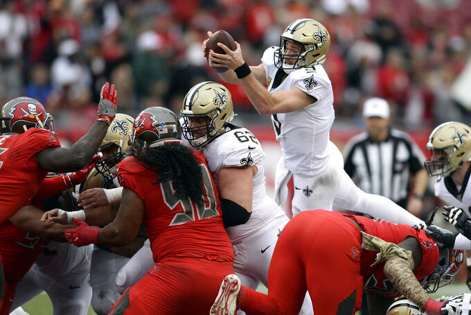 New Orleans Saints quarterback Drew Brees (9) dives over the line for a first down during the second half of an NFL football game against the Tampa Bay Buccaneers Sunday, Nov. 17, 2019, in Tampa, Fla. (AP Photo/Jason Behnken)