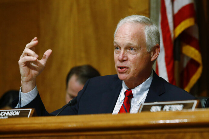 FILE - In this June 26, 2019 file photo, Sen. Ron Johnson, R-Wis., chairman of the Senate Committee on Homeland Security and Governmental Affairs, speaks during a hearing on border security, on Capitol Hill in Washington. Johnson said Friday he learned from a U.S. ambassador that President Donald Trump was tying military aid for Ukraine to an investigation of the 2016 election. But when asked if he could assure the Ukraine leadership the money would be coming, Trump blocked him from carrying that message. (AP Photo/Patrick Semansky)