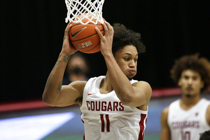 Washington State forward DJ Rodman grabs a rebound during the second half of the team's NCAA college basketball game against Oregon State in Pullman, Wash., Wednesday, Dec. 2, 2020. Washington State won 59-55. (AP Photo/Young Kwak)