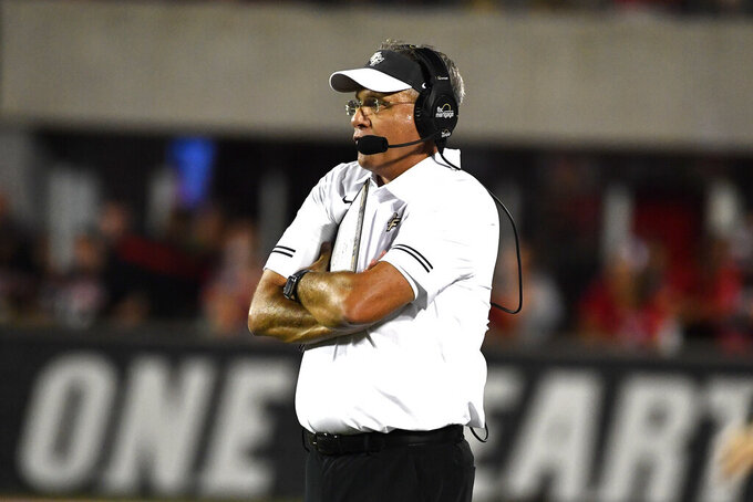 Central Florida head coach Gus Malzahn watches his team during the first half of an NCAA college football game against Louisville in Louisville, Ky., Friday, Sept. 17, 2021. (AP Photo/Timothy D. Easley)