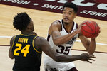Mississippi State forward Tolu Smith (35) tries to pass the ball while defended by Missouri forward Kobe Brown (24) during the first half of an NCAA college basketball game Tuesday, Jan. 5, 2021, in Starkville, Miss. (AP Photo/Rogelio V. Solis)