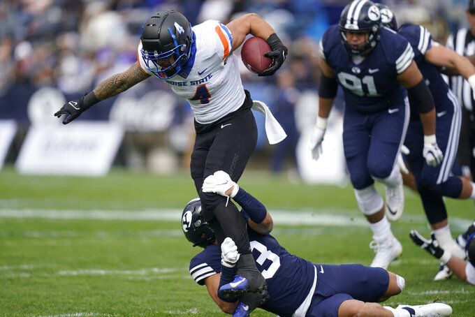 BYU linebacker Chaz Ah You (3) tackles Boise State running back Cyrus Habibi-Likio (4) in the first half during an NCAA college football game Saturday, Oct. 9, 2021, in Provo, Utah. (AP Photo/Rick Bowmer)