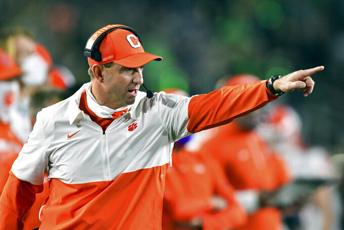 FILE - In this Saturday, Nov. 7, 2020, file photo, Clemson coach Dabo Swinney signals to his players during the second quarter against Notre Dame in an NCAA college football game in South Bend, Ind. The Notre Dame Fighting Irish beat the Clemson Tigers in a thrilling 47-40 shootout earlier this season. The big question now is if they can do it again. (Matt Cashore/Pool Photo via AP, File)