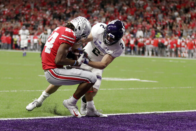 Ohio State cornerback Shaun Wade (24) intercepts a pass intended by Northwestern wide receiver Flynn Nagel (2) during the first half of the Big Ten championship NCAA college football game, Saturday, Dec. 1, 2018, in Indianapolis. (AP Photo/Michael Conroy)