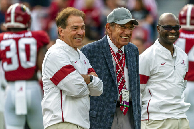Alabama head coach Nick Saban smiles as he chats with former NFL football quarterback Joe Namath, an Alabama alum, before an NCAA college football game against Arkansas, Saturday, Oct. 26, 2019, in Tuscaloosa, Ala. (AP Photo/Vasha Hunt)