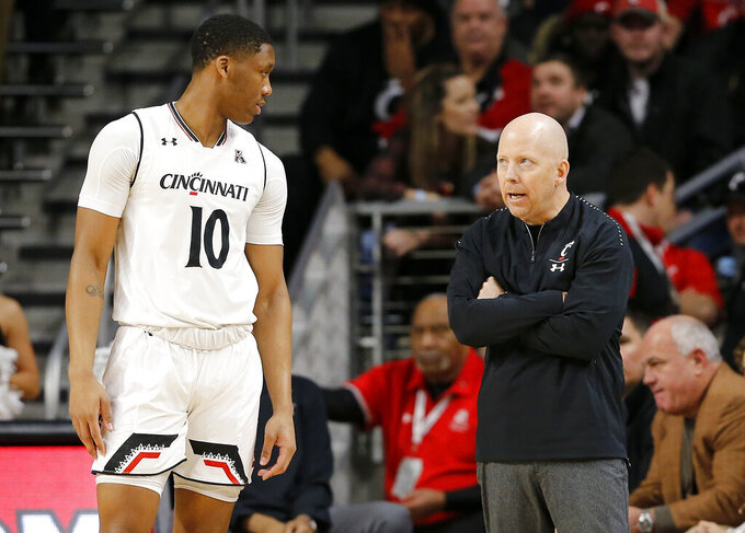 Cincinnati coach Mick Cronin talks to guard Rashawn Fredericks (10) during the first half of an NCAA college basketball game against Tulsa on Thursday, Jan. 24, 2019, in Cincinnati. (Sam Greene/The Cincinnati Enquirer via AP)