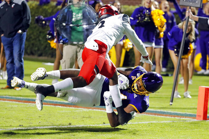 East Carolina's Zech Byrd (84) goes into the end zone while covered by Cincinnati's Ja'von Hicks (3) during the first half of an NCAA college football game in Greenville, N.C., Saturday, Nov. 2, 2019. (AP Photo/Karl B DeBlaker)
