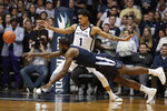 Villanova forward Eric Paschall (4) looses the ball in front of Butler forward Jordan Tucker (1) in the second half of an NCAA college basketball game in Indianapolis, Tuesday, Jan. 22, 2019. Villanova defeated Butler 80-72. (AP Photo/Michael Conroy)