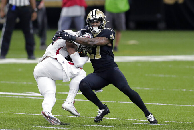 New Orleans Saints strong safety Malcolm Jenkins (27) tries to tackle Atlanta Falcons running back Todd Gurley (21) in the first half of an NFL football game in New Orleans, Sunday, Nov. 22, 2020. (AP Photo/Brett Duke)