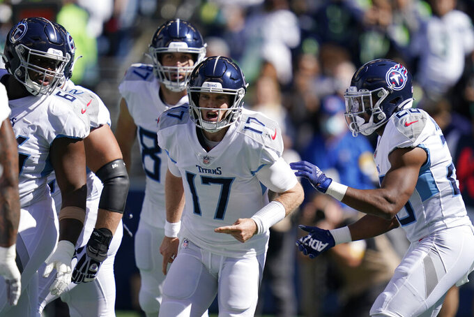 Tennessee Titans quarterback Ryan Tannehill (17) reacts on the field during the first half of an NFL football game against the Seattle Seahawks, Sunday, Sept. 19, 2021, in Seattle. (AP Photo/Elaine Thompson)