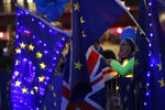 Pro EU protestors wave flags opposite parliament in London, Monday, Sept. 9, 2019. British Prime Minister Boris Johnson voiced optimism Monday that a new Brexit deal can be reached so Britain leaves the European Union by Oct. 31.(AP Photo/Frank Augstein)