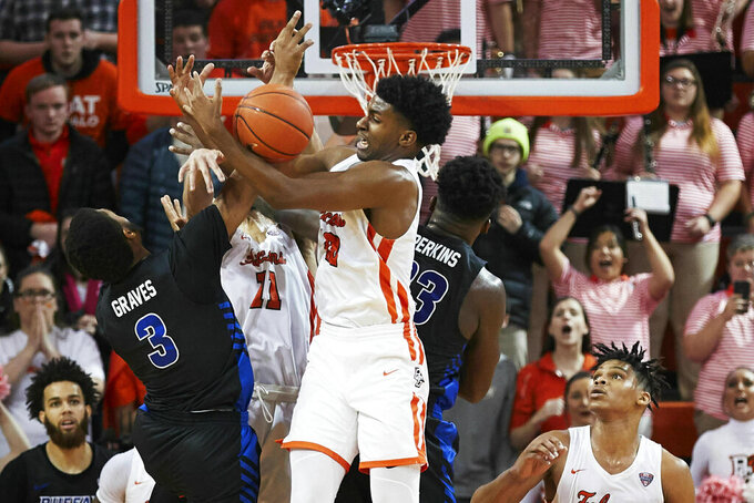 Bowling Green guard Justin Turner (10) grabs a rebound over Buffalo guard Jayvon Graves (3) in the second half of an NCAA college basketball game in Bowling Green, Ohio, Friday, Feb. 1, 2019. (AP Photo/Rick Osentoski)