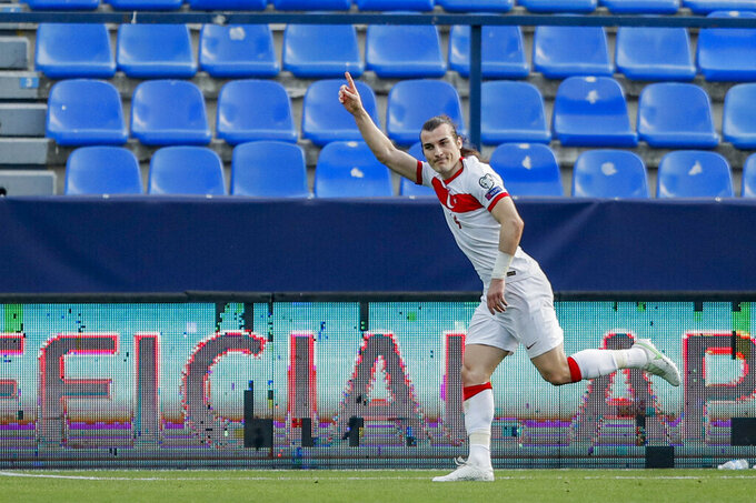 Turkey's Cablar Soyuncu celebrates after scoring his side's second goal during a World Cup 2022 group G qualifying soccer match between Norway and Turkey at La Rosaleda stadium in Malaga, Spain, Saturday, March 27, 2021. (AP Photo/Fermin Rodriguez)