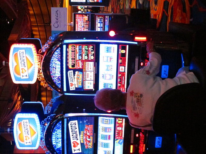 This Oct. 1, 2020 photo shows a gambler playing a slot machine at the Ocean Casino Resort in Atlantic City, N.J. On April 16, 2021, New Jersey gambling regulators released statistics showing that the Atlantic City casinos more than doubled their gambling revenue in March 2021 compared to a year earlier, when casinos were forced to shut down in mid-March due to the coronavirus pandemic. (AP Photo/Wayne Parry)