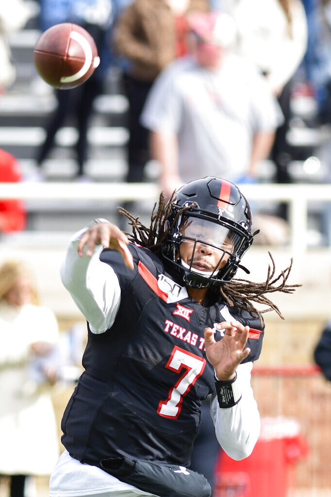 Texas Tech's Jett Duffey (7) throws the ball during the second half of an NCAA college football game against TCU, Saturday, Nov. 16, 2019, in Lubbock, Texas. (Justin Rex/Lubbock Avalanche-Journal via AP)