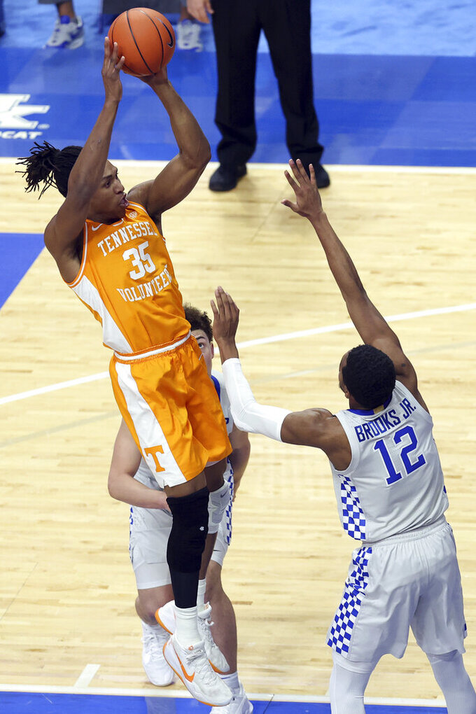 Tennessee's Yves Pons shoots over Kentucky's Keion Brooks Jr. (12) during the first half of an NCAA college basketball game in Lexington, Ky., Saturday, Feb. 6, 2021. (AP Photo/James Crisp)